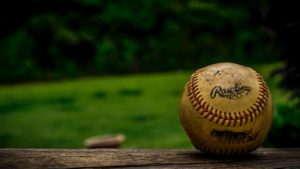 baseball on wooden bench