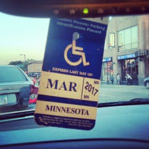 Disabled parking permit hanging placard