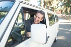 Man driving car and smiling